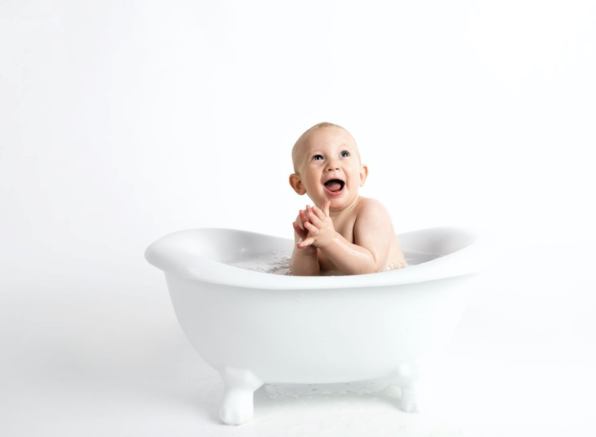 baby sitting in the tub