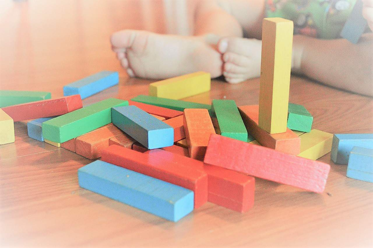 Baby Stages Of Development - Baby playing with blocks