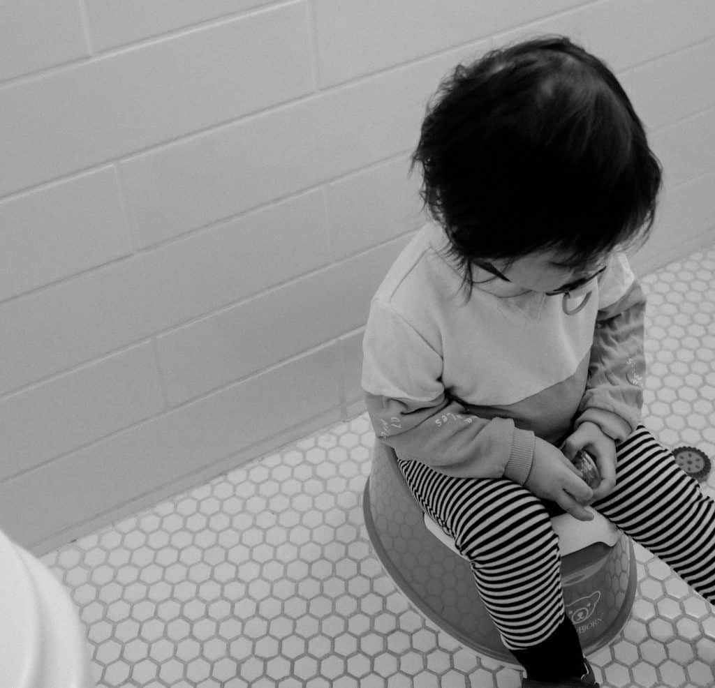 a toddler sitting on a potty seat
