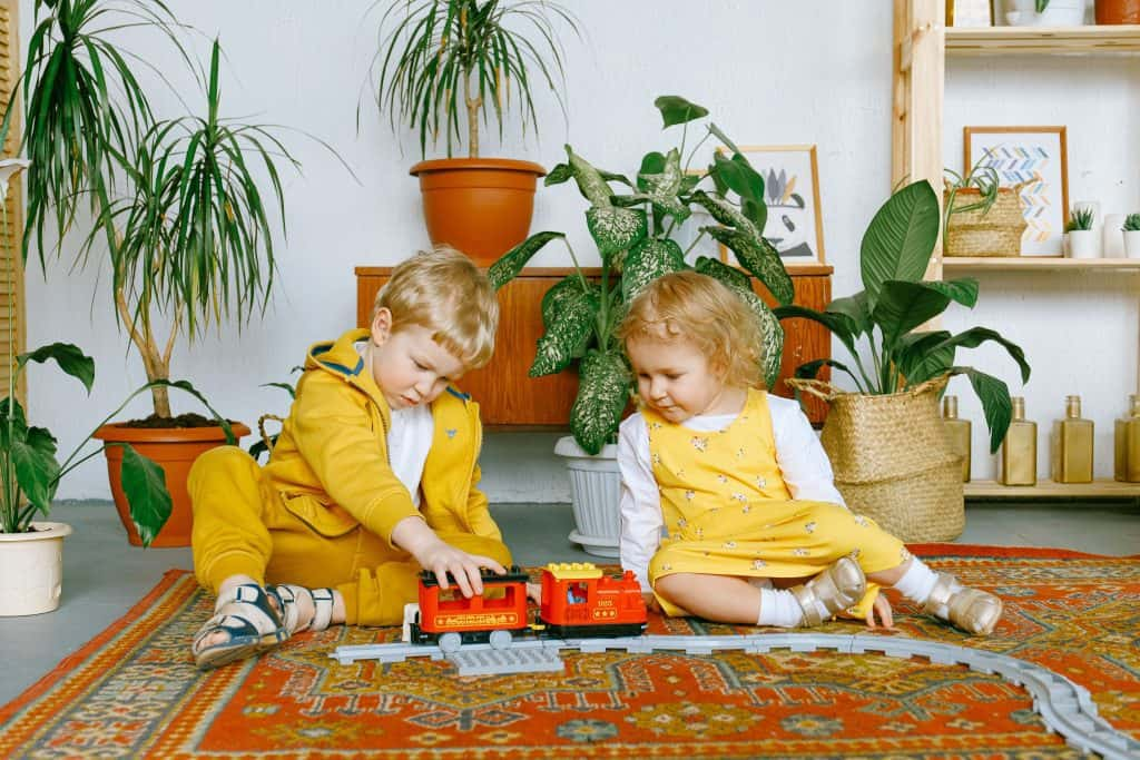 toddler boy and girl playing together