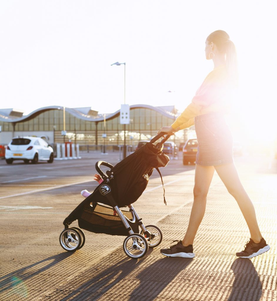 a mother with her baby in the stroller