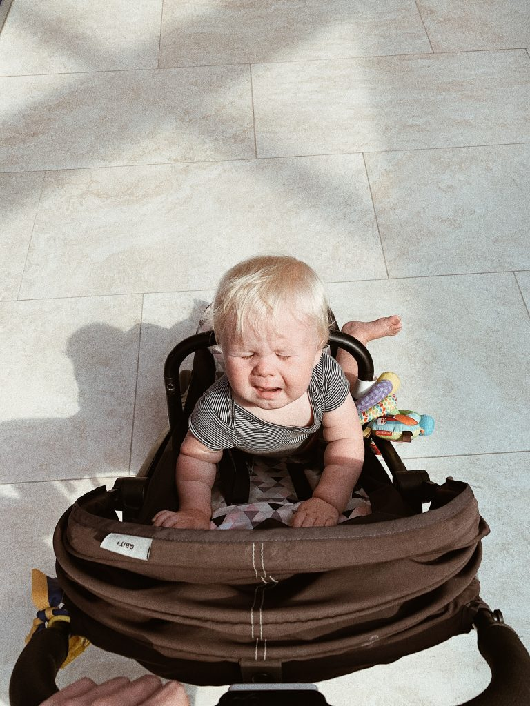 Baby crying on his stroller