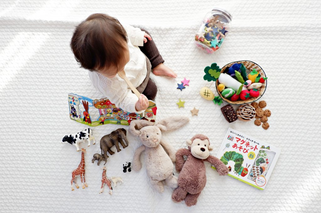 baby playing with his toys