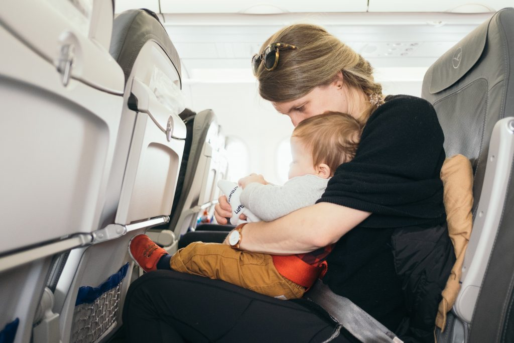 lap infant setting in an airplane