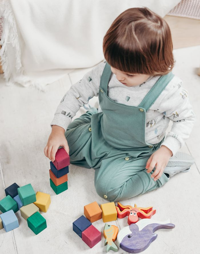 baby playing with sensory toys - blocks