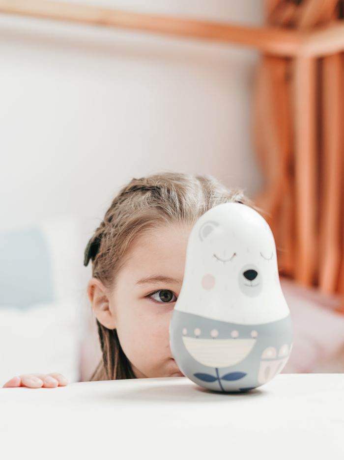a girl looking at a sensory toy