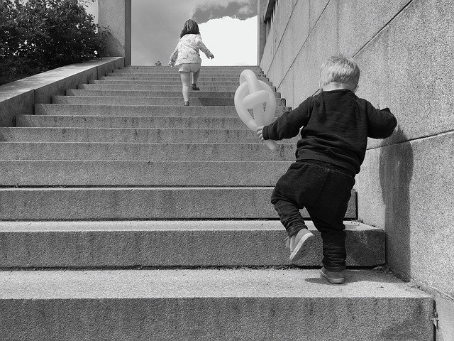 toddlers going up the stairs