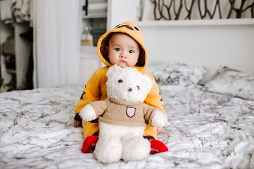 baby with his teddy