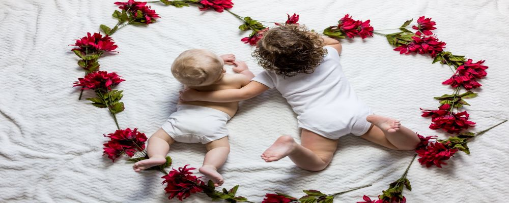 brothers laying down in a bed